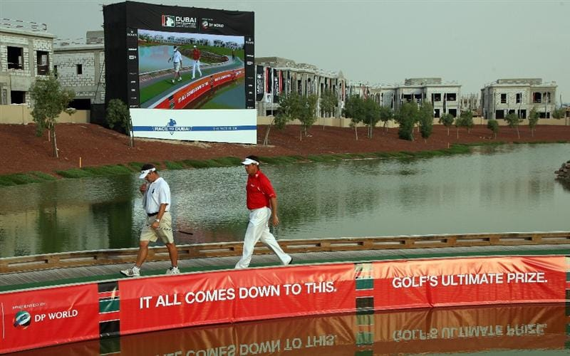 DUBAI, UNITED ARAB EMIRATES - NOVEMBER 22:  Lee Westwood of England walks from the green at the 17th hole with his caddie Billy Foster during the final round of the Dubai World Championship, on the Earth Course, Jumeirah Golf Estates on November 22, 2009 in Dubai, United Arab Emirates  (Photo by David Cannon/Getty Images)