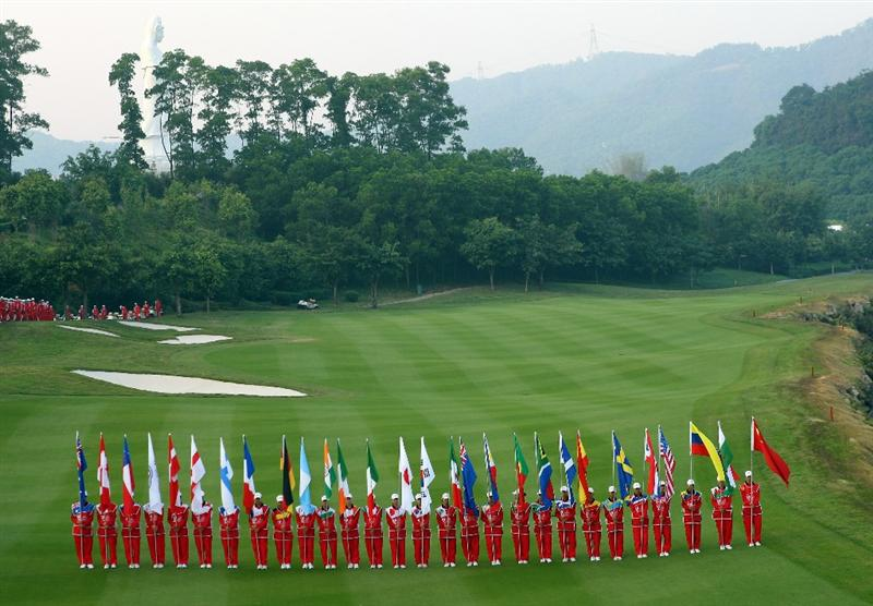 SHENZHEN, CHINA - NOVEMBER 26:  Flag carriers  during the opening ceremony of the Omega Mission Hills World Cup at the Mission Hills Resort on November 26, 2008 in Shenzhen, China.  (Photo by Stuart Franklin/Getty Images)