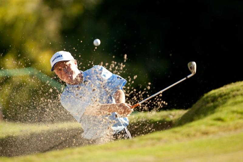 SAN ANTONIO, TX - OCTOBER 31: Jeff Sluman follows through on a bunker shot during the final round of the AT&T Championship at Oak Hills Country Club on October 31, 2010 in San Antonio, Texas. (Photo by Darren Carroll/Getty Images)