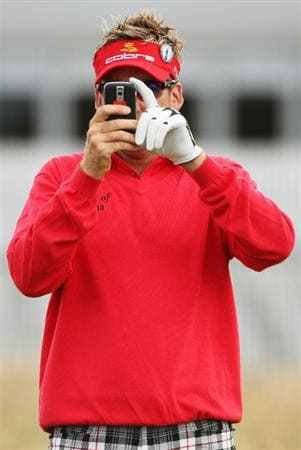 TURNBERRY, SCOTLAND - JULY 14:  Ian Poulter of England takes a picture with his mobile phone during a practice round prior to the 138th Open Championship on July 14, 2009 on the Ailsa Course, Turnberry Golf Club, Turnberry, Scotland.  (Photo by Andrew Redington/Getty Images)