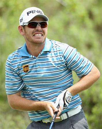 CASARES, SPAIN - MAY 19:  Louis Oosthuizen of South Africa grimaces as he tees off on the third hole during the group stages of the Volvo World Match Play Championships at Finca Cortesin on May 19, 2011 in Casares, Spain.  (Photo by Warren Little/Getty Images)
