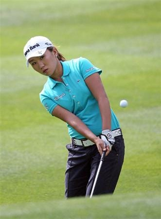 CALGARY, AB - SEPTEMBER 05 : In-Kyung Kim of South Korea hits her third shot on the fourth hole during the third round of the Canadian Women's Open at Priddis Greens Golf & Country Club on September 5, 2009 in Calgary, Alberta, Canada. (Photo by Hunter Martin/Getty Images)