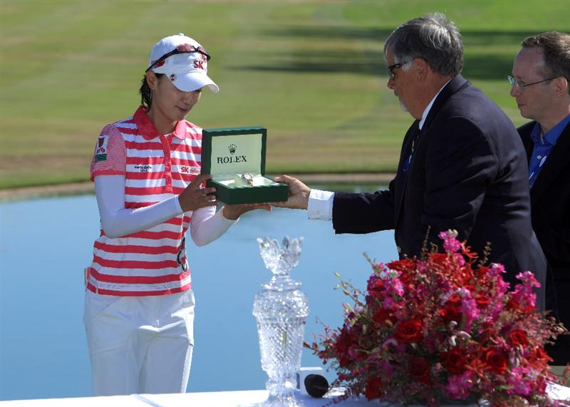 LA JOLLA, CA - SEPTEMBER 20:  Na Yeon Choi of South Korea is presented her Rolex Watch after her -16 under par victory during the final round of the LPGA Samsung World Championship on September 20, 2009 at Torrey Pines Golf Course in La Jolla, California.  (Photo By Donald Miralle/Getty Images)