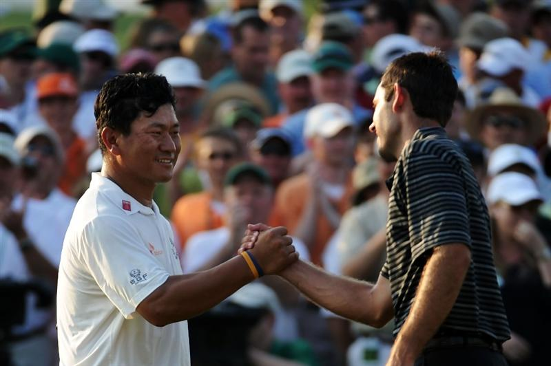 AUGUSTA, GA - APRIL 10:  Charl Schwartzel of South Africa (R) shakes hands with K.J. Choi of South Africa on the 18th green during the final round of the 2011 Masters Tournament at Augusta National Golf Club on April 10, 2011 in Augusta, Georgia.  (Photo by Harry How/Getty Images)