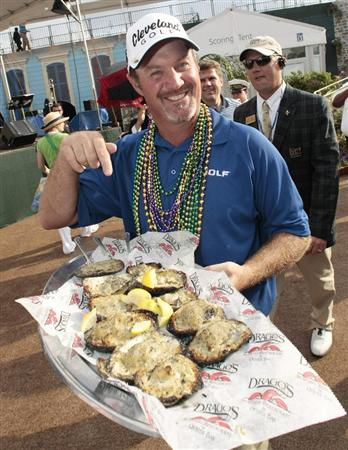 AVONDALE, LA - APRIL 26: Zurich Classic winner Jerry Kelly gestures to a tray of charbroiled as he makes his way to the interview room after his win during the final round of the Zurich Classic at TPC Louisiana on April 26, 2009  in Avondale, Louisiana. (Photo by Dave Martin/Getty Images)