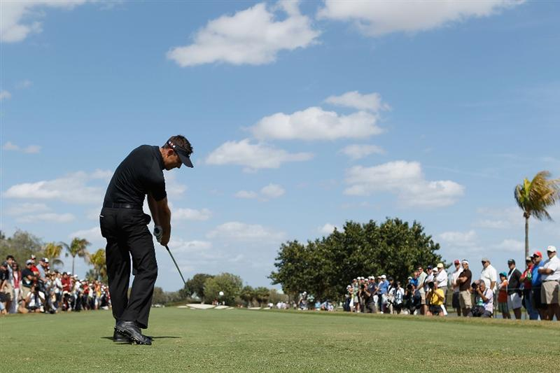 DORAL, FL - MARCH 14:  Charl Schwartzel of South Africa tees off on the fifth tee box during the final round of the 2010 WGC-CA Championship at the TPC Blue Monster at Doral on March 14, 2010 in Doral, Florida.  (Photo by Scott Halleran/Getty Images)
