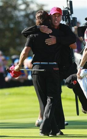 NEWPORT, WALES - OCTOBER 04: Corey Pavin USA Team captain hugs Rickie Fowler of the USA on the 18th green after he halved his single match during the 2010 Ryder Cup at the Celtic Manor Resort on October 4, 2010 in Newport, Wales.  (Photo by Andrew Redington/Getty Images)