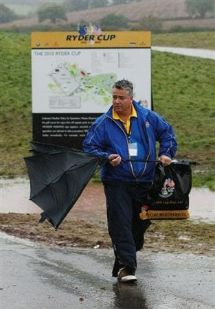 NEWPORT, WALES - OCTOBER 03:  A marshal leaves the course prior to the restart of the Fourball & Foursome Matches during the 2010 Ryder Cup at the Celtic Manor Resort on October 3, 2010 in Newport, Wales.  (Photo by Andrew Redington/Getty Images)