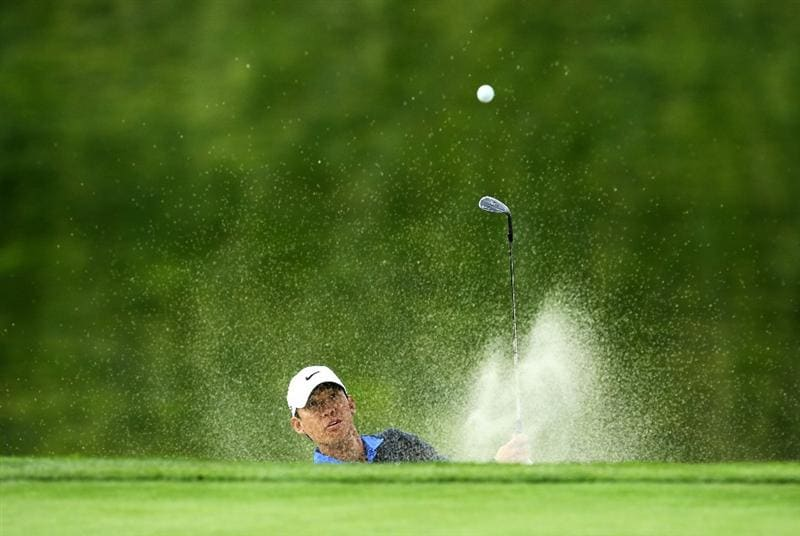 LA JOLLA, CA - JANUARY 30:  Anthony Kim hits out of a bunker on the 13th hole during the final round of the Farmers Insurance Open at Torrey Pines South Course on January 30, 2011 in La Jolla, California.  (Photo by Stephen Dunn/Getty Images)