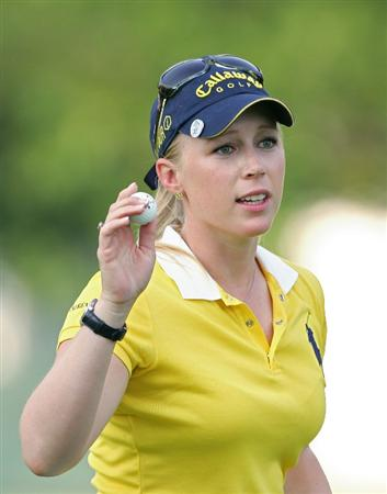 PITTSFORD, NY - JUNE 27: Morgan Pressel of the USA acknowledges the gallery as she finishes her round during the third round of the Wegmans LPGA at Locust Hill Country Club held on June 27, 2009 in Pittsford, NY. (Photo by Michael Cohen/Getty Images)