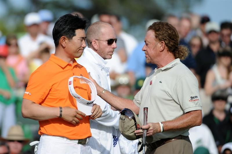 AUGUSTA, GA - APRIL 07:  Y.E. Yang of South Korea shakes hands with Miguel Angel Jimenez of Spain after finishing on the 18th hole during the first round of the 2011 Masters Tournament at Augusta National Golf Club on April 7, 2011 in Augusta, Georgia.  (Photo by Harry How/Getty Images)