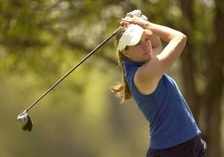 Brittany Lang of Duke follows through on her tee shot at the 14th hole during final round action at the 2005 ACC Women's Golf Championship, April 17, 2005.  Lang would finish the tournament with a +3 219 to win her second consecutive individual title, and led the Duke women to their 10th consecutive team title in the process.Photo by Brian A.  Westerholt/WireImage.com