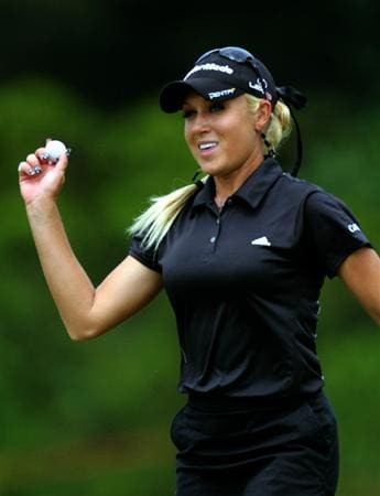 KUALA LUMPUR, MALAYSIA - OCTOBER 24 : Natalie Gulbis of USA acknowledges the cheers after sinking a birdie on the 14th hole during the Final Round of the Sime Darby LPGA on October 24, 2010 at the Kuala Lumpur Golf and Country Club in Kuala Lumpur, Malaysia. (Photo by Stanley Chou/Getty Images)