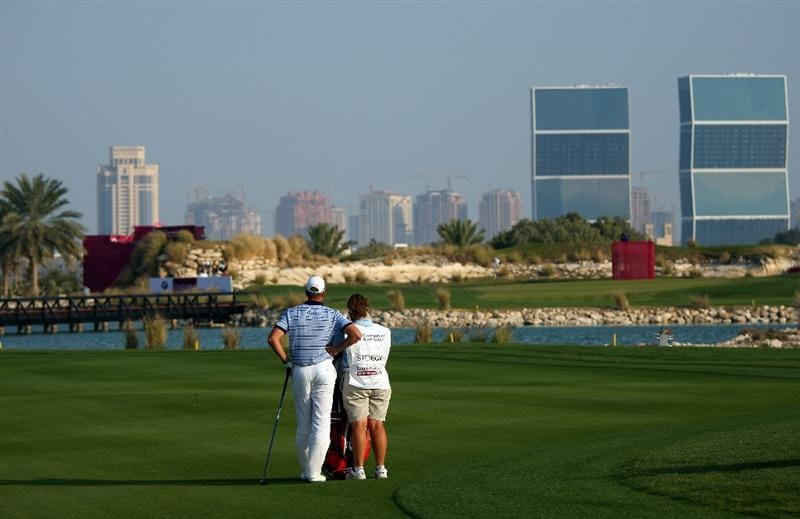 DOHA, QATAR - JANUARY 25:  Henrik Stenson of Sweden waits with his caddie Fanny Sunesson on the 15th hole during the final round of the Commercialbank Qatar Masters at Doha Golf Club on January 25, 2009 in Doha, Qatar.  (Photo by Andrew Redington/Getty Images)