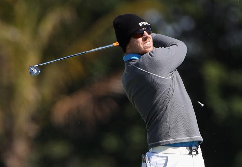 DORAL, FL - MARCH 11:  Hunter Mahan hits his tee shot on the ninth hole during the completion of the first round of the 2011 WGC- Cadillac Championship at the TPC Blue Monster at the Doral Golf Resort and Spa on March 11, 2011 in Doral, Florida.  (Photo by Sam Greenwood/Getty Images)
