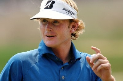Brandt Snedeker acknowledges the gallery after making a birdie putt on the ninth green during the final round of the Wyndham Championship at Forest Oaks Country Club on August 19, 2007 in Greensboro, North Carolina. PGA TOUR - 2007 Wyndham Championship - Final RoundPhoto by Jonathan Ernst/WireImage.com