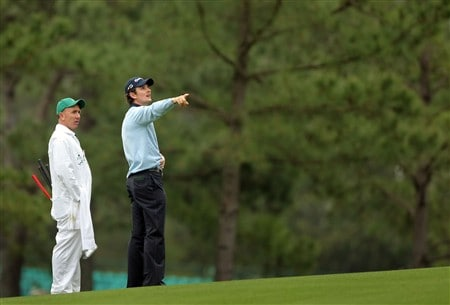 AUGUSTA, GA - APRIL 08:  Justin Rose of England stands on the course with his caddie Michael Doran during the second day of practice prior to the start of the 2008 Masters Tournament at Augusta National Golf Club on April 8, 2008 in Augusta, Georgia.  (Photo by Harry How/Getty Images)