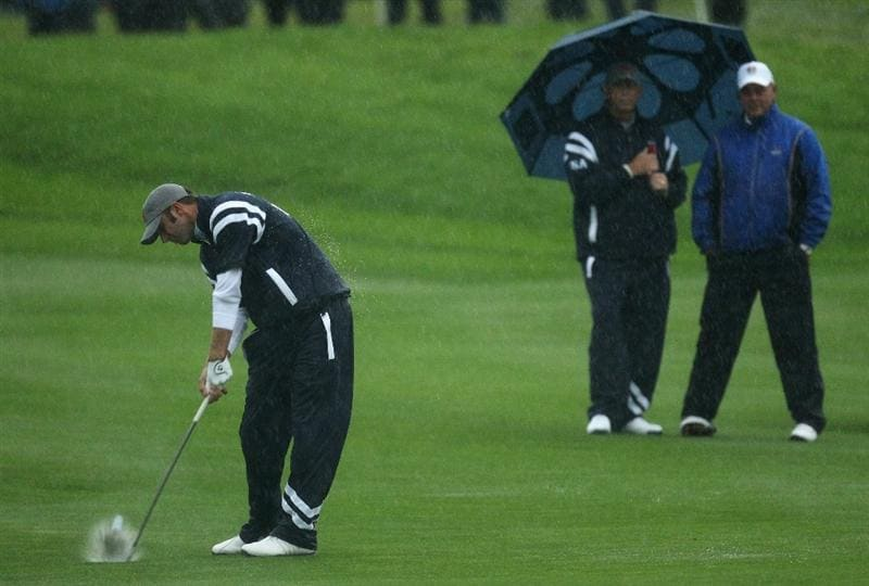 NEWPORT, WALES - OCTOBER 01:  Dustin Johnson of the USA hits a shot on the second hole as the rain falls during the Morning Fourball Matches during the 2010 Ryder Cup at the Celtic Manor Resort on October 1, 2010 in Newport, Wales.  (Photo by Ross Kinnaird/Getty Images)