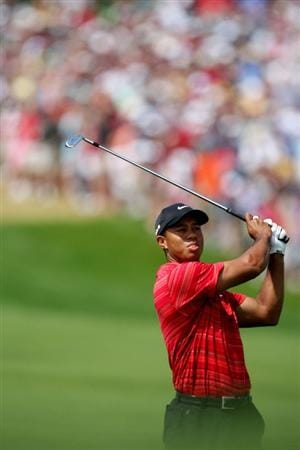 CHASKA, MN - AUGUST 16:  Tiger Woods hits his approach shot on the first hole during the final round of the 91st PGA Championship at Hazeltine National Golf Club on August 16, 2009 in Chaska, Minnesota.  (Photo by David Cannon/Getty Images)