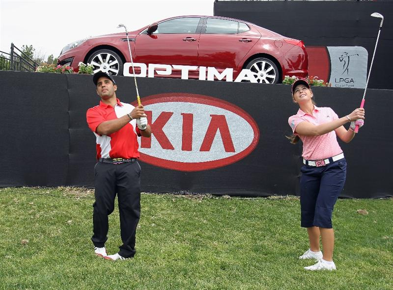 CITY OF INDUSTRY, CA - MARCH 23:  Paula Creamer (R) hits a shot alongside NASCAR driver Juan Pablo Montoya during the pro-am prior to the start of the Kia Classic on March 23, 2011 at the Industry Hills Golf Club in the City of Industry, California.  (Photo by Scott Halleran/Getty Images for LPGA)