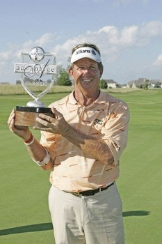 Dana Quigley holds the trophy after winning the playoff round of the Bayer Advantage Classic held at LionsGate Golf Course in Overland Park, KS. on June 13, 2005.Photo by G. Newman Lowrance/WireImage.com