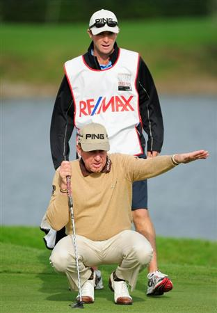 VIENNA, AUSTRIA - SEPTEMBER 17:  Miguel Angel Jimenez of Spain and caddie Mike Kerr lines up a putt on the 16th hole during the second round of the Austrian golf open presented by Botarin at the Diamond country club on September 17, 2010 in Atzenbrugg near Vienna, Austria  (Photo by Stuart Franklin/Getty Images)