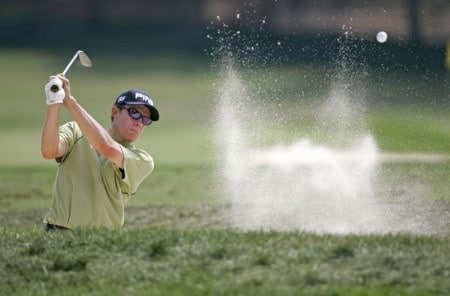 Nick O'Hern blasts out of a bunker during practice for the NEC Invitational at Firestone Country Club in Akron, Ohio on August 17, 2005.Photo by Sam Greenwood/WireImage.com