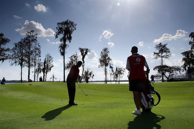 ORLANDO, FL - MARCH 16: J.B.Holmes of the USA hits his third shot at the 18th hole during the first day of the 2009 Tavistock Cup at the Lake Nona Golf and Country Club, on March 16, 2009 in Orlando, Florida  (Photo by David Cannon/Getty Images)
