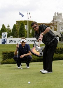European Tour Golfer Ian Poulter gives INXS lead Guitarist Tim Farriss some valuable golf tips at Wentworth. Farriss is due to plays in the BMW PGA Championship Pro-Am, on Wednesday May 23rd, before INXS perform live at the 'Concert on the Course.'