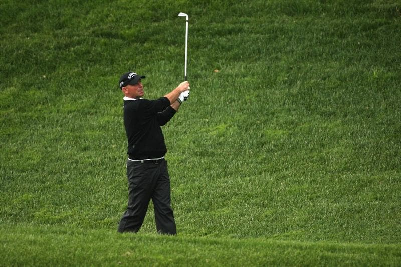 GIRONA, SPAIN - APRIL 30:  Thomas Bjorn of Denmark plays his second shot into the 18th green during the first round of the Open de Espana at the PGA Golf Catalunya on April 30, 2009 in Girona, Spain.  (Photo by Warren Little/Getty Images)