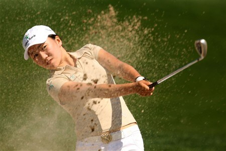 SUPERSTITION MOUNTAIN, ARIZONA - MARCH 27:  In-Kyung Kim of South Korea plays a bunker shot on the 18th hole during the first round of the Safeway International at Superstition Mountain Golf and Country Club  on March 27, 2008 in Superstition Mountain, Arizona.  (Photo by Scott Halleran/Getty Images)