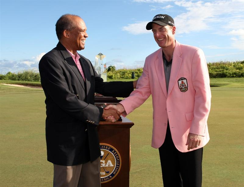 TUCKER'S TOWN, BERMUDA - OCTOBER 15: Dr. Ewart F. Brown the Premier of Bermuda presents Jim Furyk with a Pink Jacket after the final round of the PGA Grand Slam of Golf at the Mid Ocean Club on October 15, 2008 in Tucker's Town, Bermuda. (Photo by Ross Kinnaird/Getty Images)