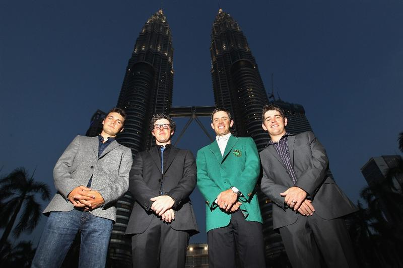 KUALA LUMPUR, MALAYSIA - APRIL 13:  Martin Kaymer of Germany, Rory McIlroy of Northern Ireland, Charl Schwartzel and Louis Oosthuizen of South Africa poses for photos outside the Petronas Towers prior to the Maybank Malaysian Open at Kuala Lumpur Golf & Country Club on April 13, 2011 in Kuala Lumpur, Malaysia.  (Photo by Ian Walton/Getty Images)