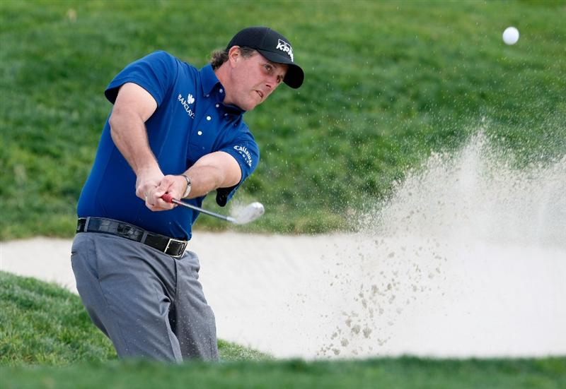LA JOLLA, CA - FEBRUARY 05:  Phil Mickelson hits a bunker shot to the 11th green during the first round of the Buick Invitational at the Torrey Pines South Course on February 5, 2009 in La Jolla, California.  (Photo by Jeff Gross/Getty Images)
