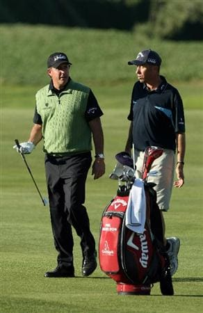 LA JOLLA, CA- JANUARY 26:  Phil Mickelson waits with his caddie Jim 'Bones' Mackay on the 17th fairway during the Pro-Am at the Farmers Insurance Open at Torrey Pines on January 26, 2011 in La Jolla, California. (Photo by Donald Miralle/Getty Images)