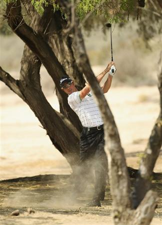 DUBAI, UNITED ARAB EMIRATES - FEBRUARY 12:  Brett Rumford of Australia in action during the third round for the 2011 Omega Dubai desert Classic held on the Majilis Course at the Emirates Golf Club on February 12, 2011 in Dubai, United Arab Emirates.  (Photo by Ian Walton/Getty Images)