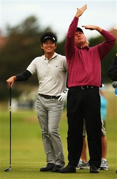 SOUTHPORT, UNITED KINGDOM - JULY 15:  Ryuji Imada of Japan chats with Greg Norman of Australia on the sixth tee during the second practice round of the 137th Open Championship on July 15, 2008 at Royal Birkdale Golf Club, Southport, England.  (Photo by Richard Heathcote/Getty Images)
