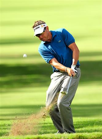 HONOLULU,HI - JANUARY 16:  Robert Allenby of Australia plays a shot on the 9th hole during the third round of the Sony Open at Waialae Country Club on January 16, 2010 in Honolulu, Hawaii.  (Photo by Sam Greenwood/Getty Images)