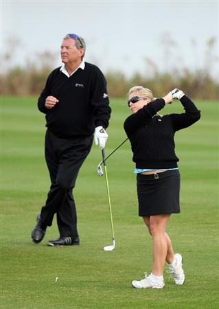 CHAMPIONS GATE, FL - DECEMBER 06:  Fuzzy Zoeller of the USA watches his daughter Gretchen Zoeller as she hits her second shot at the 1st hole during the first round of the Del Webb Father Son Challenge on the International Course at Champions Gate Golf Club on December 6, 2008 in Champions Gate, Florida.  (Photo by David Cannon/Getty Images)