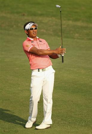 NEW DELHI, INDIA - FEBRUARY 19:  Thongchai Jaidee of Thailand hits an iron shot during the third round of the Avantha Masters held at The DLF Golf and Country Club on February 19, 2011 in New Delhi, India.  (Photo by Ian Walton/Getty Images)