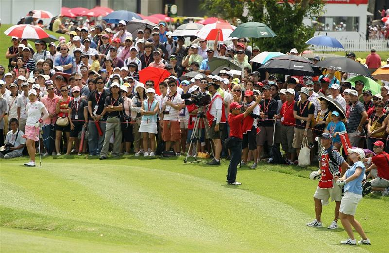 SINGAPORE - FEBRUARY 27:  Karrie Webb of Australia watches her pitch shot to the 16th green as Chie Arimura of Japan looks on during the final round of the HSBC Women's Champions 2011 at the Tanah Merah Country Club on February 27, 2011 in Singapore, Singapore.  (Photo by Scott Halleran/Getty Images)