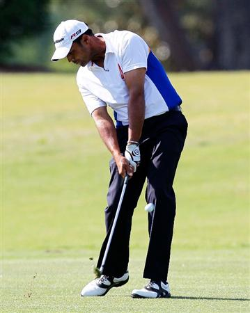 ATHENS, GA - APRIL 29:  Arjun Atwal of India plays his second shot from the 10th fairway during the first round of the 2010 Stadion Athens Classic at the University of Georgia Golf Course on April 29, 2010 in Athens, Georgia.  (Photo by Kevin C. Cox/Getty Images)