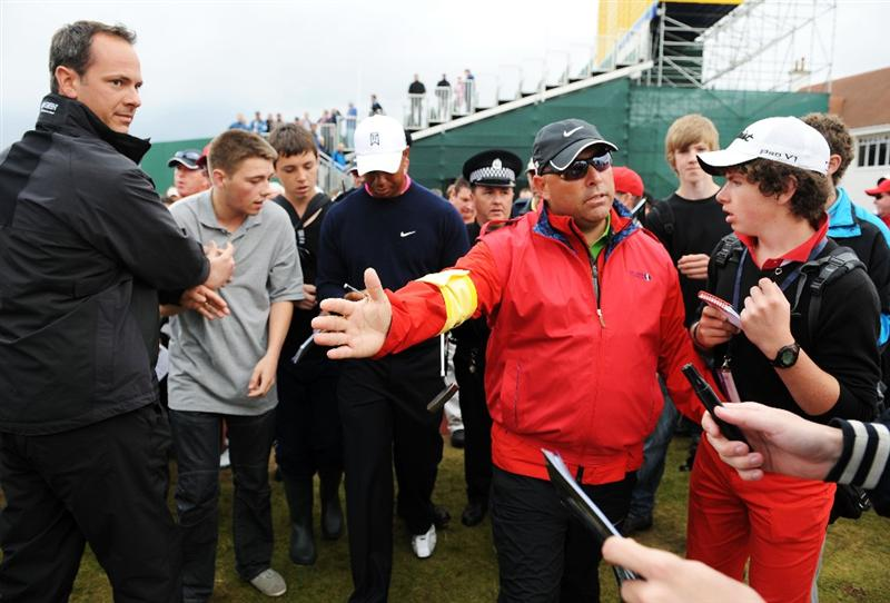 TURNBERRY, SCOTLAND - JULY 13:  Tiger Woods of the USA signs autographs for spectators during the practice round of the 138th Open Championship on July 13, 2009 on the Ailsa Course, Turnberry Golf Club, Turnberry, Scotland.  (Photo by Harry How/Getty Images)