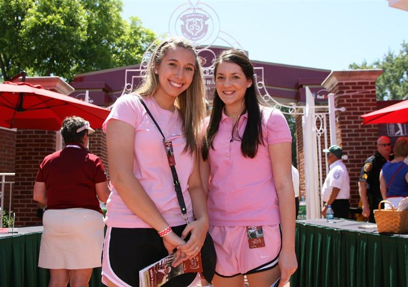 FT. WORTH, TX - MAY 30: Two golf fans wear pink shirts to show their support for Amy Mickelson and breast cancer research during the third round of the Crowne Plaza Invitational at Colonial Country Club on May 30, 2009 in Ft. Worth, Texas. (Photo by Hunter Martin/Getty Images)