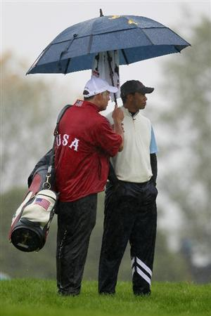 NEWPORT, WALES - OCTOBER 01:  Tiger Woods of the USA waits with his caddie Steve Williams as the rain falls during the Morning Fourball Matches during the 2010 Ryder Cup at the Celtic Manor Resort on October 1, 2010 in Newport, Wales.  (Photo by Andy Lyons/Getty Images)