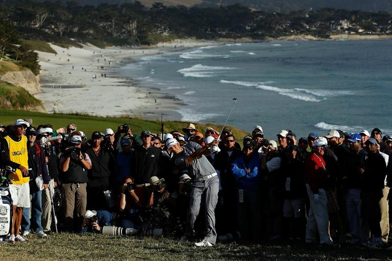PEBBLE BEACH, CA - JUNE 19:  Dustin Johnson hits his second shot on the 13th hole during the third round of the 110th U.S. Open at Pebble Beach Golf Links on June 19, 2010 in Pebble Beach, California.  (Photo by Donald Miralle/Getty Images)