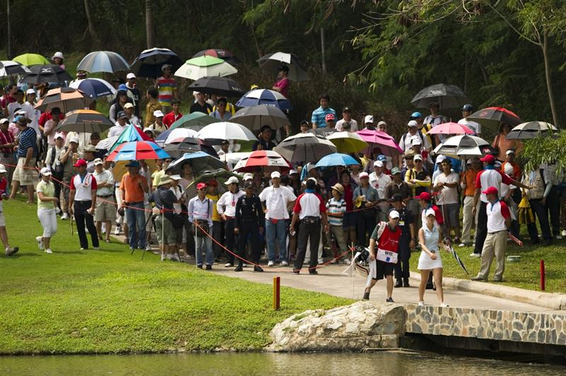 CHON BURI, THAILAND - FEBRUARY 21:  Michelle Wie of USA looks on her way to the 8th hole during the final round of the Honda PTT LPGA Thailand at Siam Country Club on February 21, 2010 in Chon Buri, Thailand.  (Photo by Victor Fraile/Getty Images)