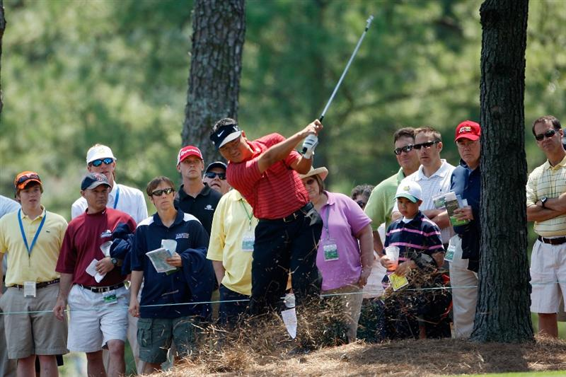 AUGUSTA, GA - APRIL 09:  K.J. Choi of Korea hits from the pine needles during the first round of the 2009 Masters Tournament at Augusta National Golf Club on April 9, 2009 in Augusta, Georgia.  (Photo by Jamie Squire/Getty Images)