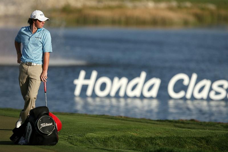 PALM BEACH GARDENS, FL - MARCH 07:  Rory McIlroy waits to putt on the 18th hole during the third round of The Honda Classic at PGA National Resort and Spa on March 7, 2009 in Palm Beach Gardens, Florida.  (Photo by Doug Benc/Getty Images)