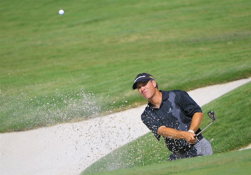 IRVING TX  - MAY 21:  Scott McCarron blasts out of the greenside bunker on the 2nd hole during the first round of  the HP Byron Nelson Championship held at the TPC Four Seasons Resort Las Colinas on May 21, 2009 in Irving, Texas.  (Photo by Marc Feldman/Getty Images)